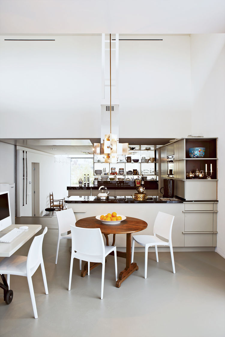 Modern kitchen with wooden table by Frank Bolink