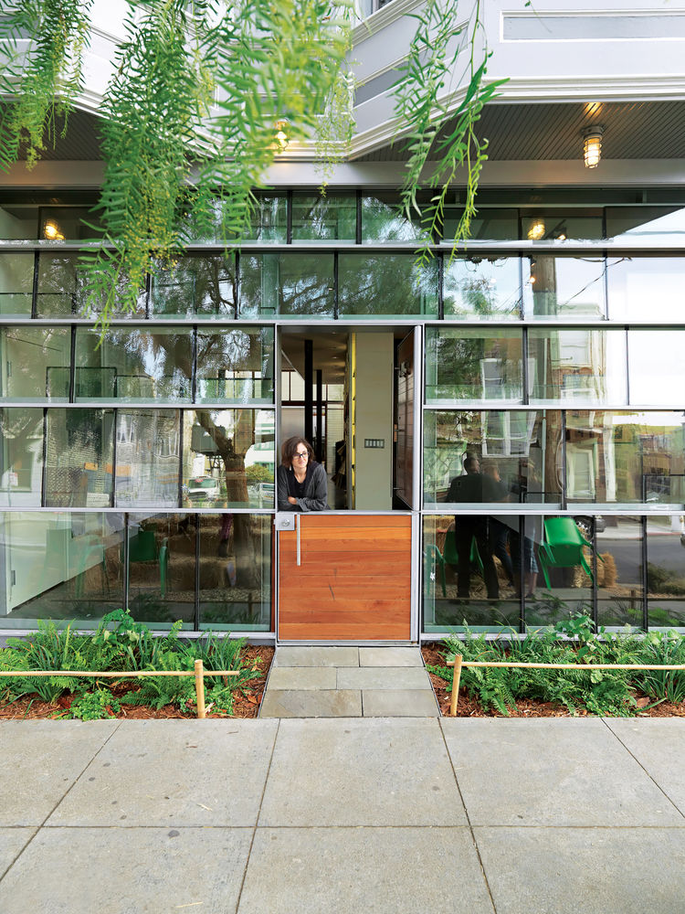Storefront facade with salvaged double-insulated window glass panels