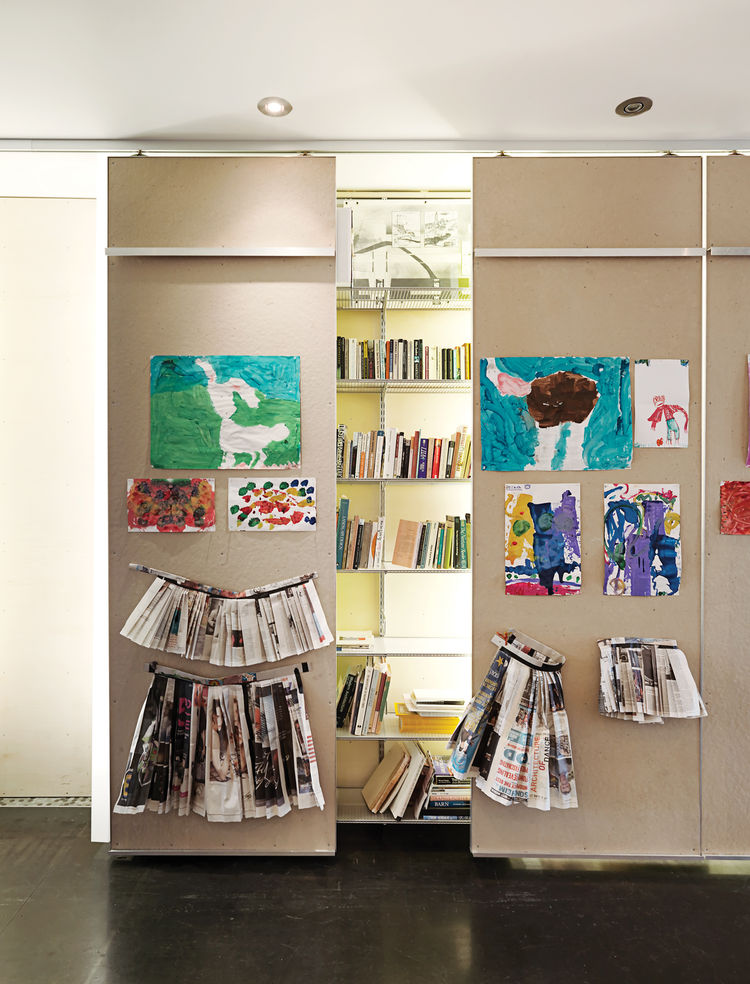 Ground-floor gallery with library shelving