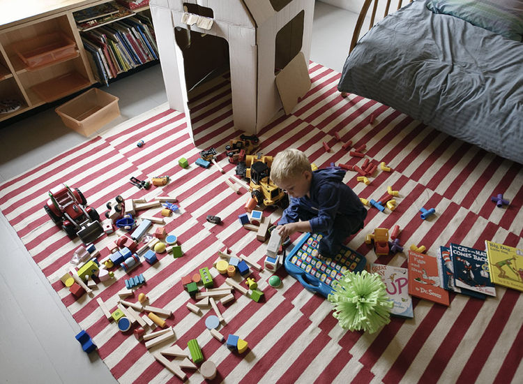 Little boy's playroom with Pottery Barn striped rug