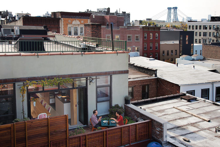 Outdoor fenced dining porch area in Brooklyn, New York