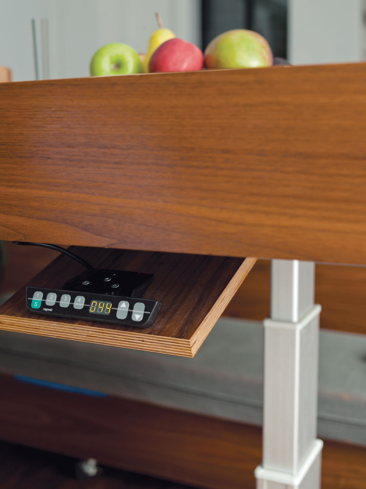 Multipurpose walnut dining table hydraulic controls and hidden drawers