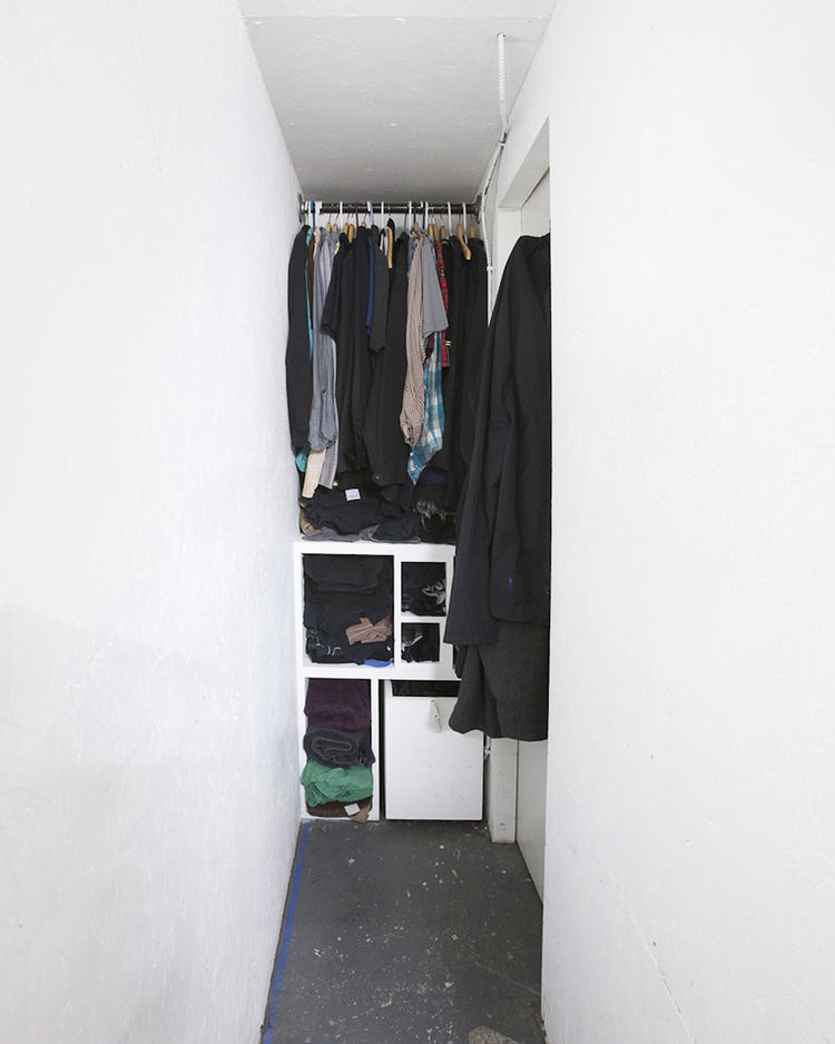Narrow walk-in closet space