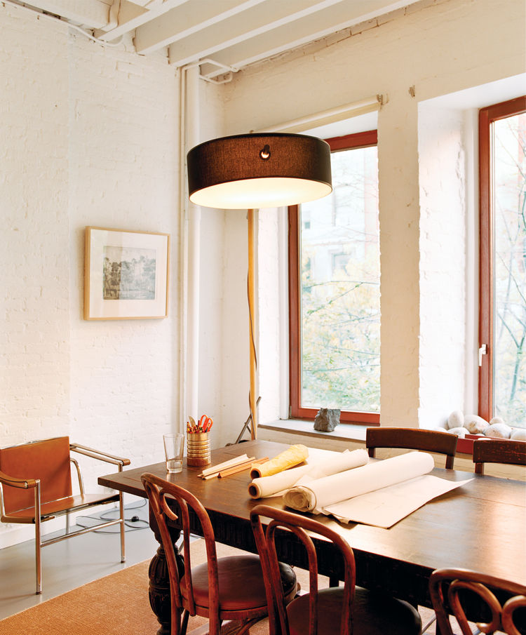 Dining table area with weather-and sound-resistant windows and central air-conditioning system
