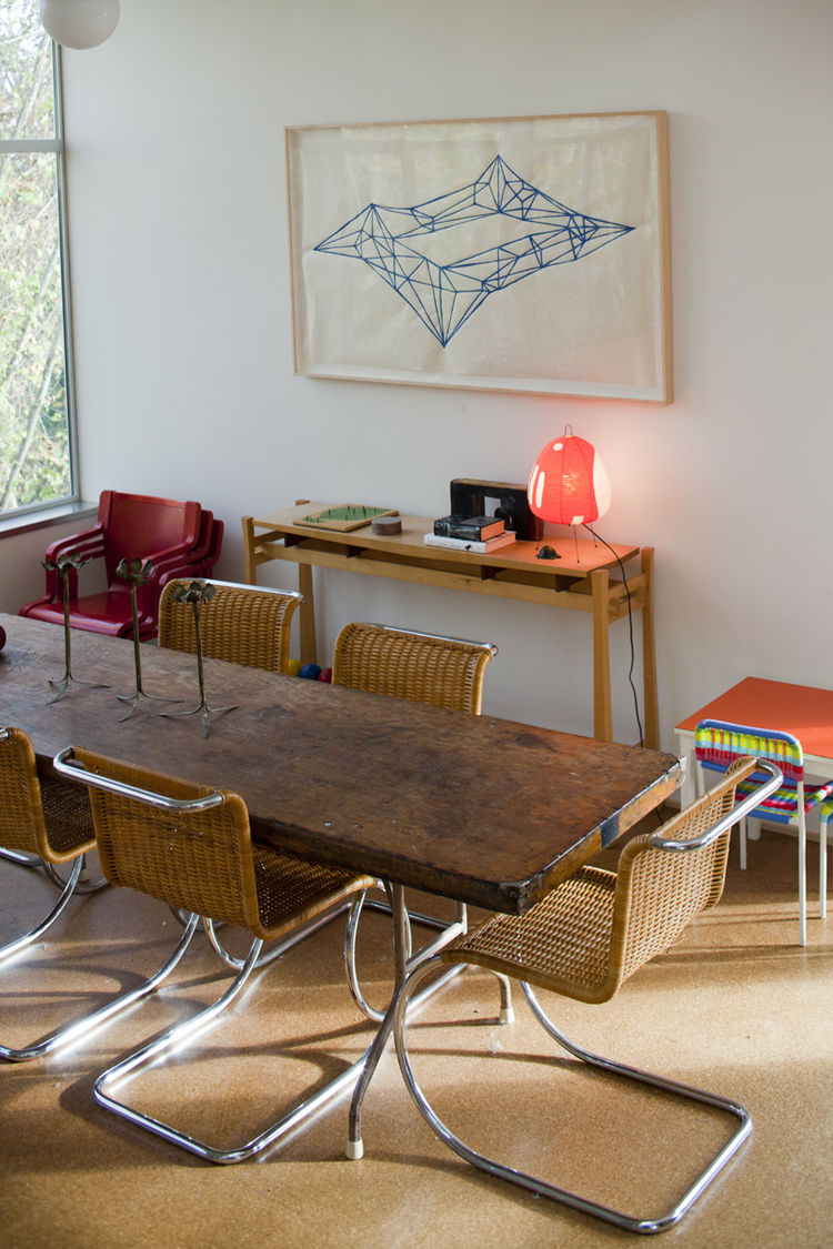Dining room with Mies van der Rohe chairs and Victoria Haven painting