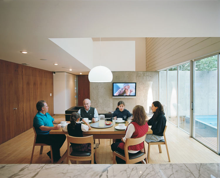 Family portrait in the double-height dining room