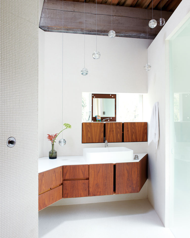 Modern bathroom with floating wooden countertop