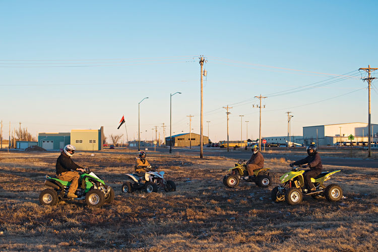 Motor bikers on a flat dirt road in Greensburg, Kansas