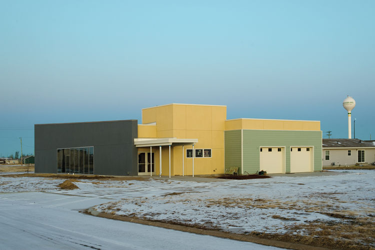 Modern funeral home with insulated concrete form and Trombe wall