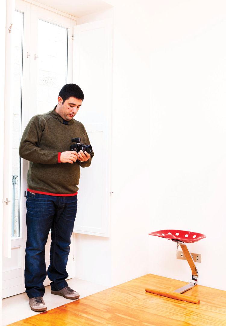 Alberto Moncada by a Achille Castiglioni's Mezzadro stool