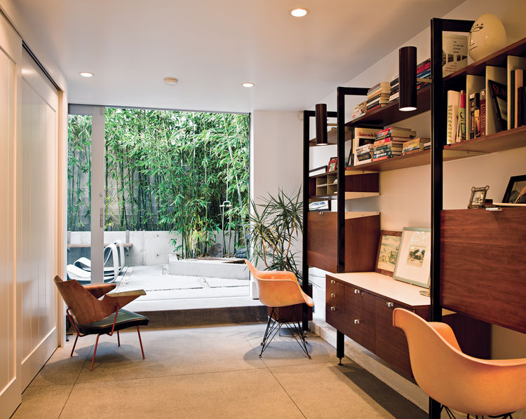 Office with a bentwood Robin Day chair and overview of the outdoor shower