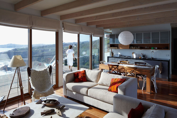 Modern living room with gray linen sofas and beach view