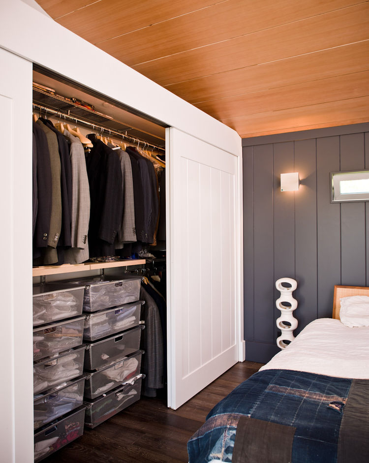 Upstairs studio bedroom with a vintage Japanese indigo quilt and sliding door closet
