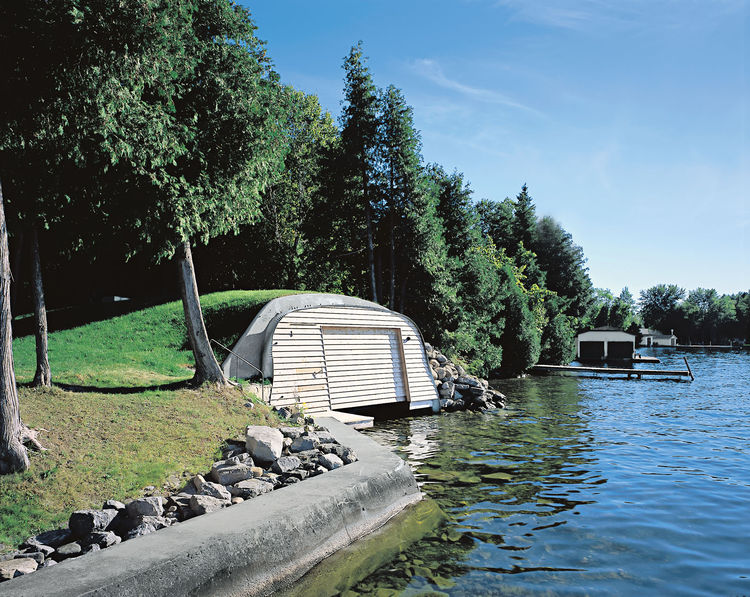 Modern boathouse with giant steel arches