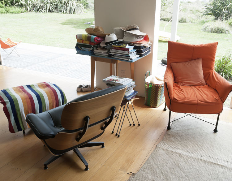 Living room with Eames lounger and custom-made orange chair