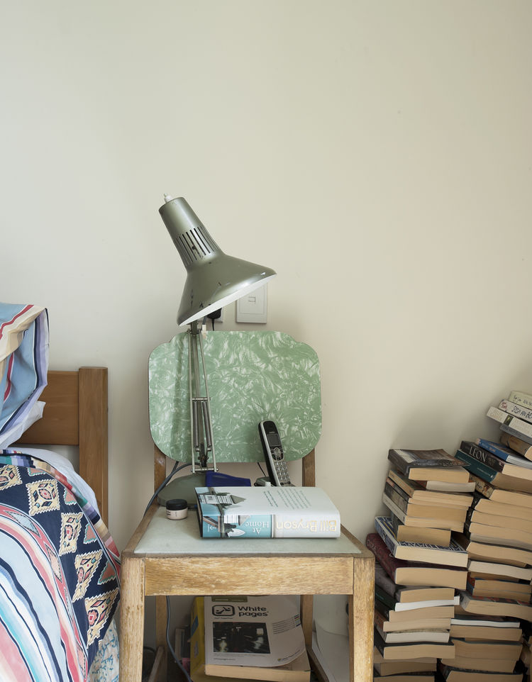 Books and lamp by night stand