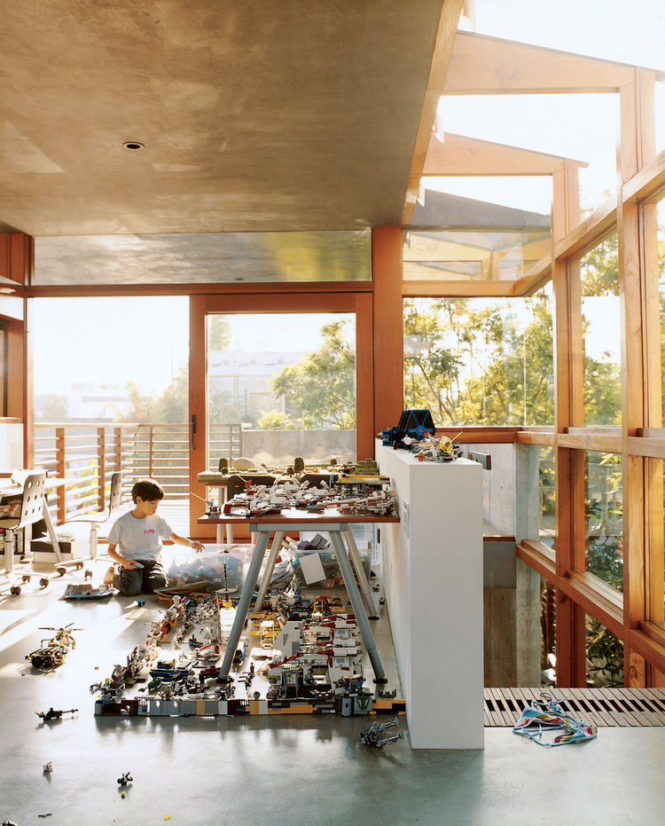 "In the new addition to the Hertz/Fong residence in Venice, California, architect David Hertz's son Max tinkers with his extensive array of Legos and War Hammer miniatures in the upstairs office/playroom. <a href=""http://www.dwell.com/articles/sustainabili"
