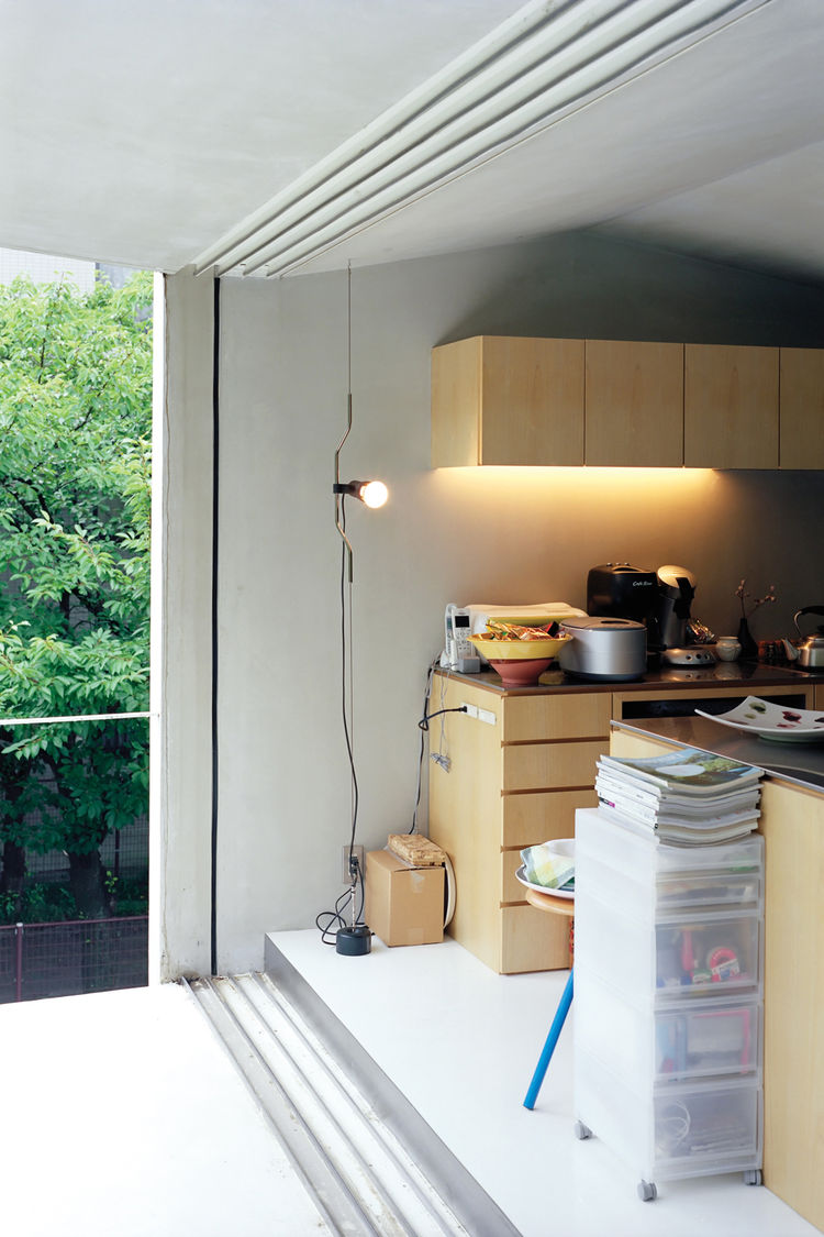 Kitchen with custom-made paulownia cabinets and balcony view