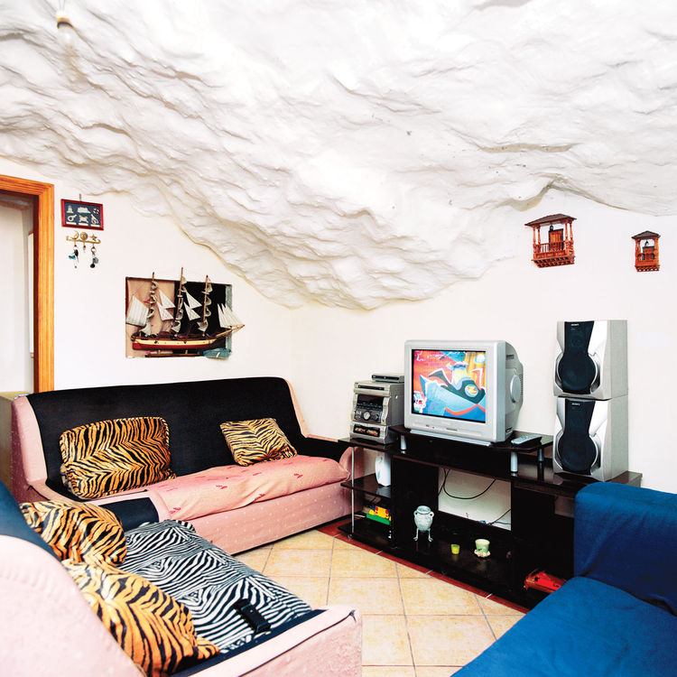 Compact living room with volcano rock ceiling
