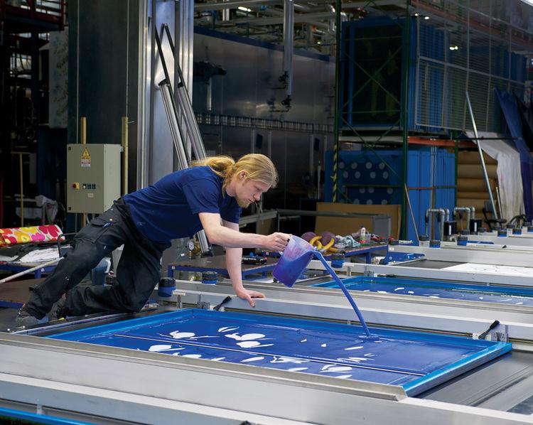 Marimekko employee adding ink to a print