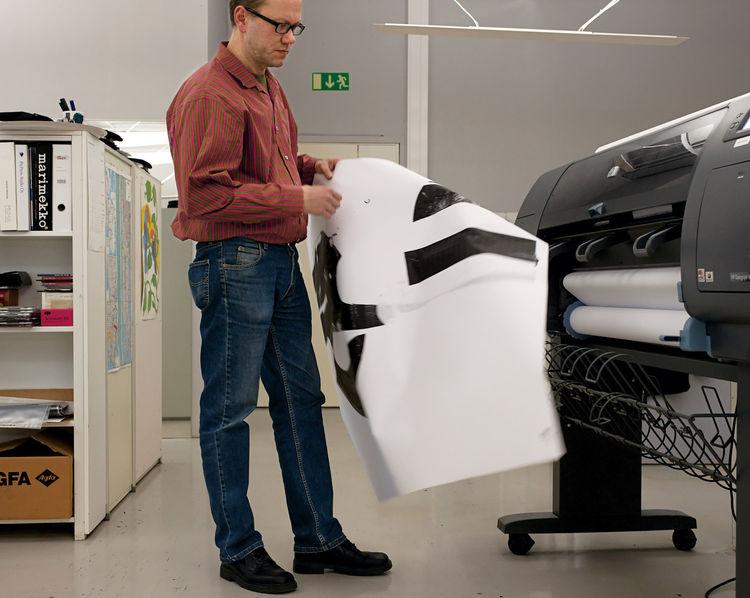 Marimekko Studio Manager Petri Juslin inspecting a printout