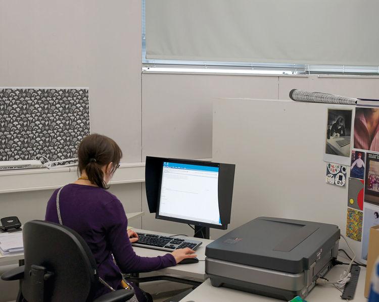 Designer on the computer at the Marimekko factory