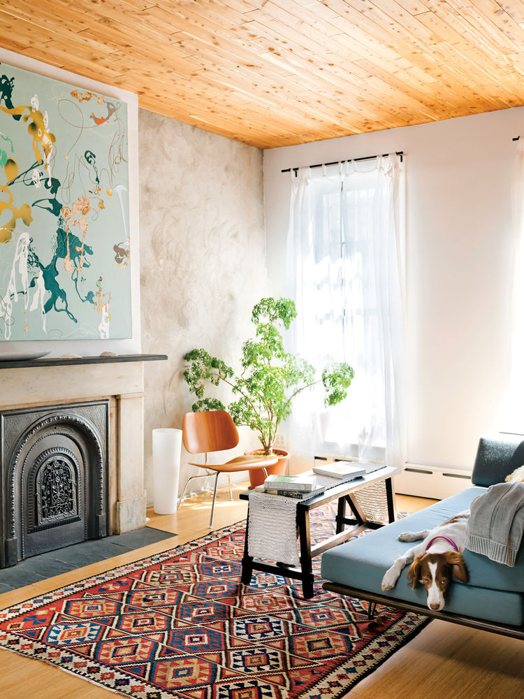Creative living room with an Eames chair and decorative rug