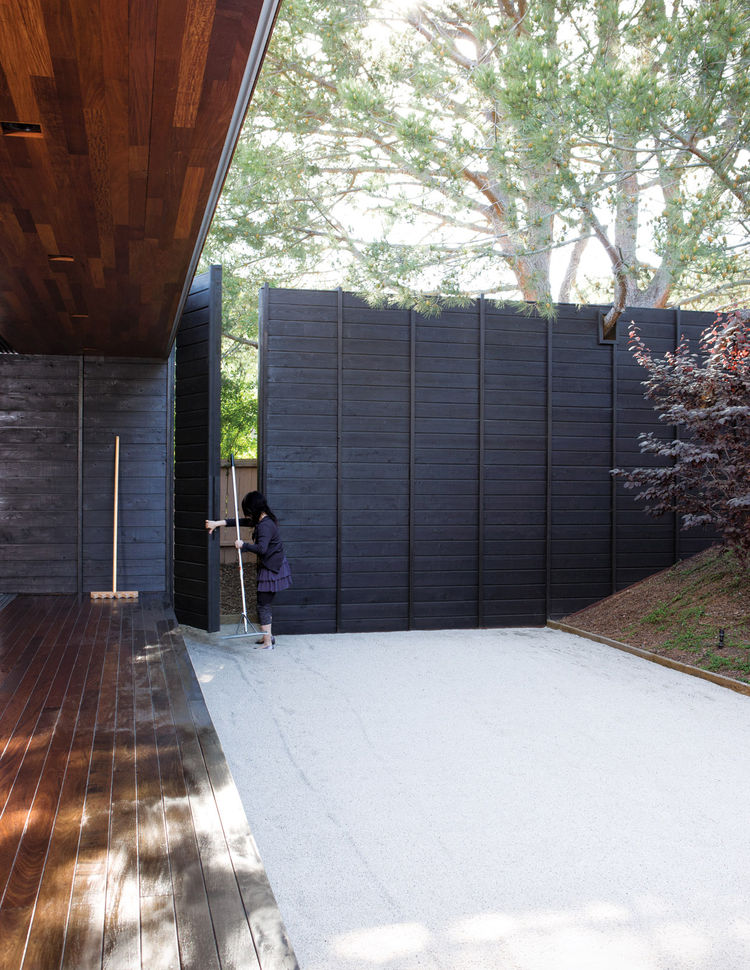 Japanese-style rock garden by the outdoor fence