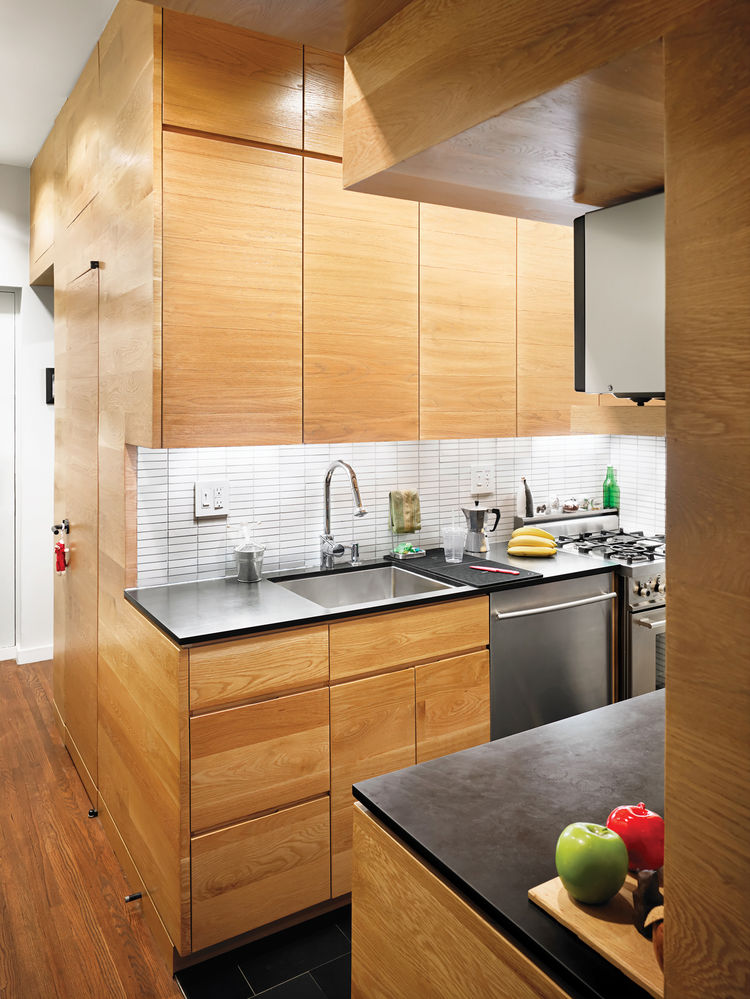 Modern kitchen with oak paneling