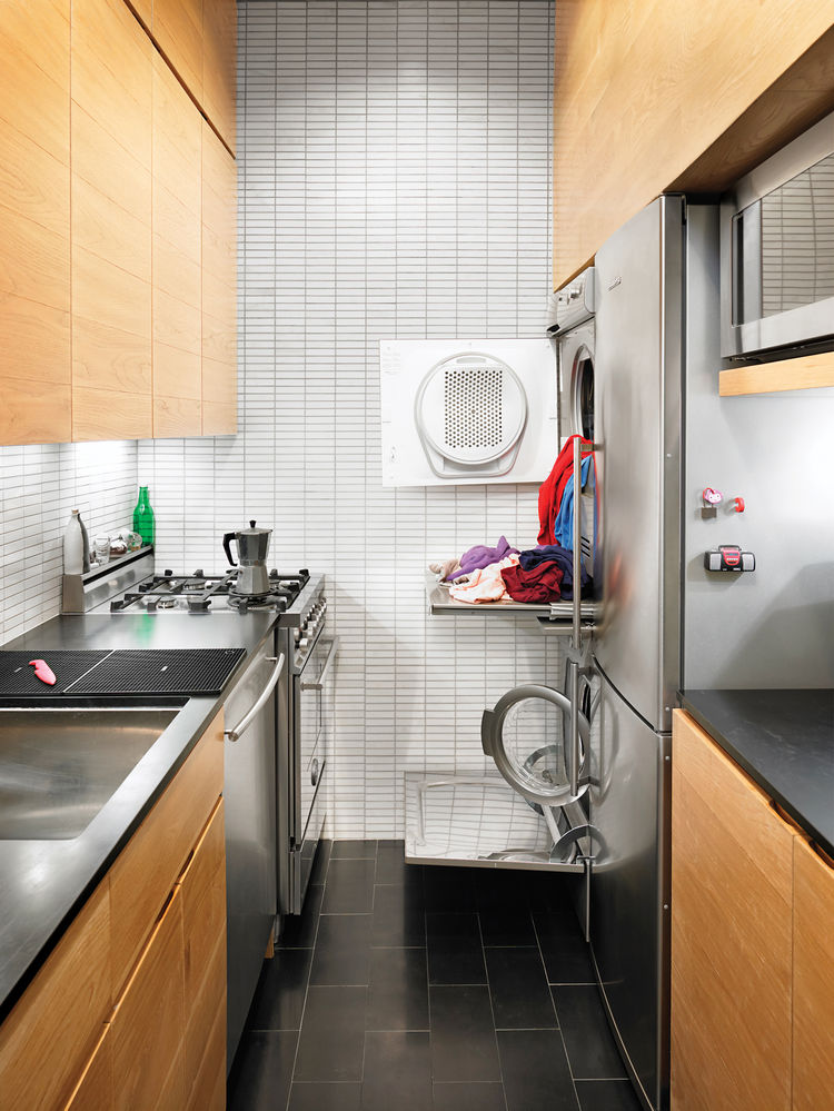 Small kitchen with Asko washer-dryer and full-size refrigerator