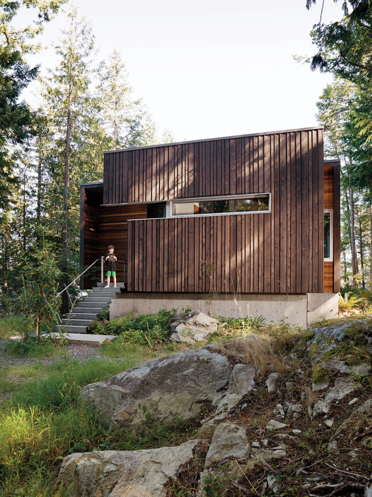 Sustainable cabin façade with beveled siding