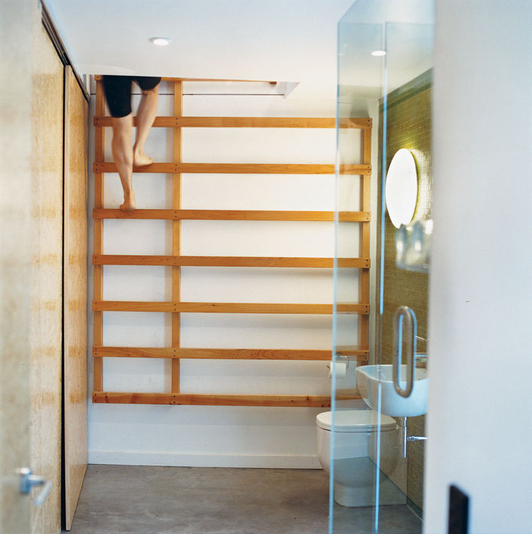 One bathroom features a ladder that leads up to a yoga studio.