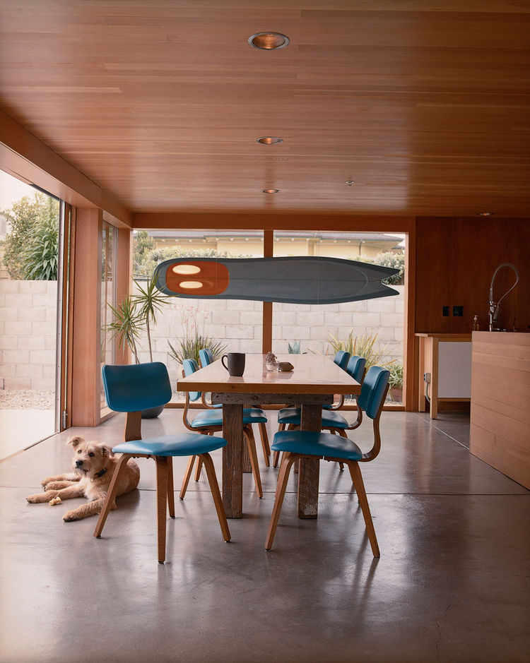 """To inexpensively re-create a classic modern look for a wood-paneled ceiling in a Montara, California, dining room, architect Michael Maltzan used Douglas fir tongue-and-groove flooring. <a href=""""http://www.dwell.com/articles/the-full-montara.html"""">Read th"""