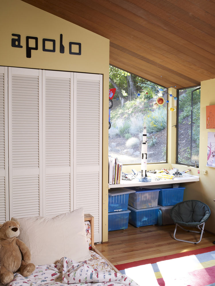 Modern little boys bedroom with space decorations