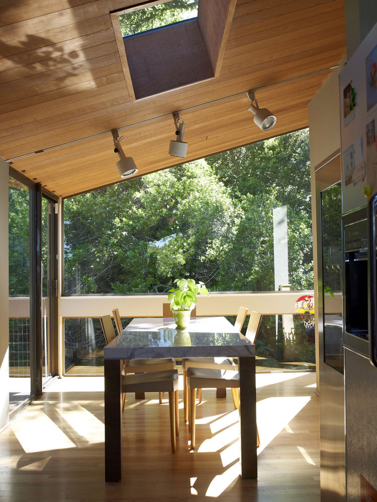 Dining room with big glass windows and cut-out ceiling window