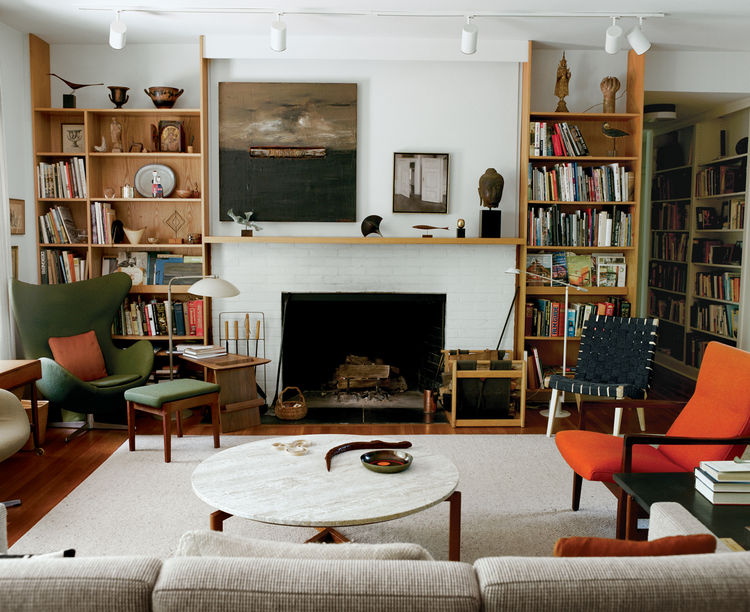 One of the few pieces of furniture in the Risom living room not designed by Risom himself is the Egg chair by fellow Dane Arne Jacobsen. A painting by Sven Hammershoj graces the mantle.