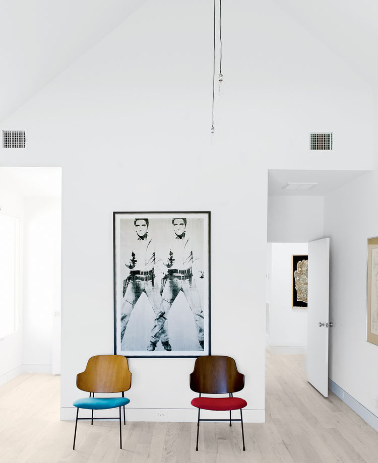 Modern upstairs bedroom with Kofod-Larsen chairs and Warhol print