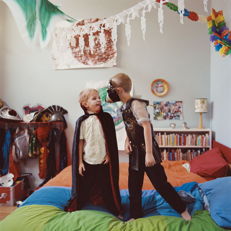 "Moe and Lewis play in their shared bedroom, the former Madame Wong's kitchen. ""It's just so fun for them to live in a funny place like this,"" says Amy. ""Their friends love to come over and play."""