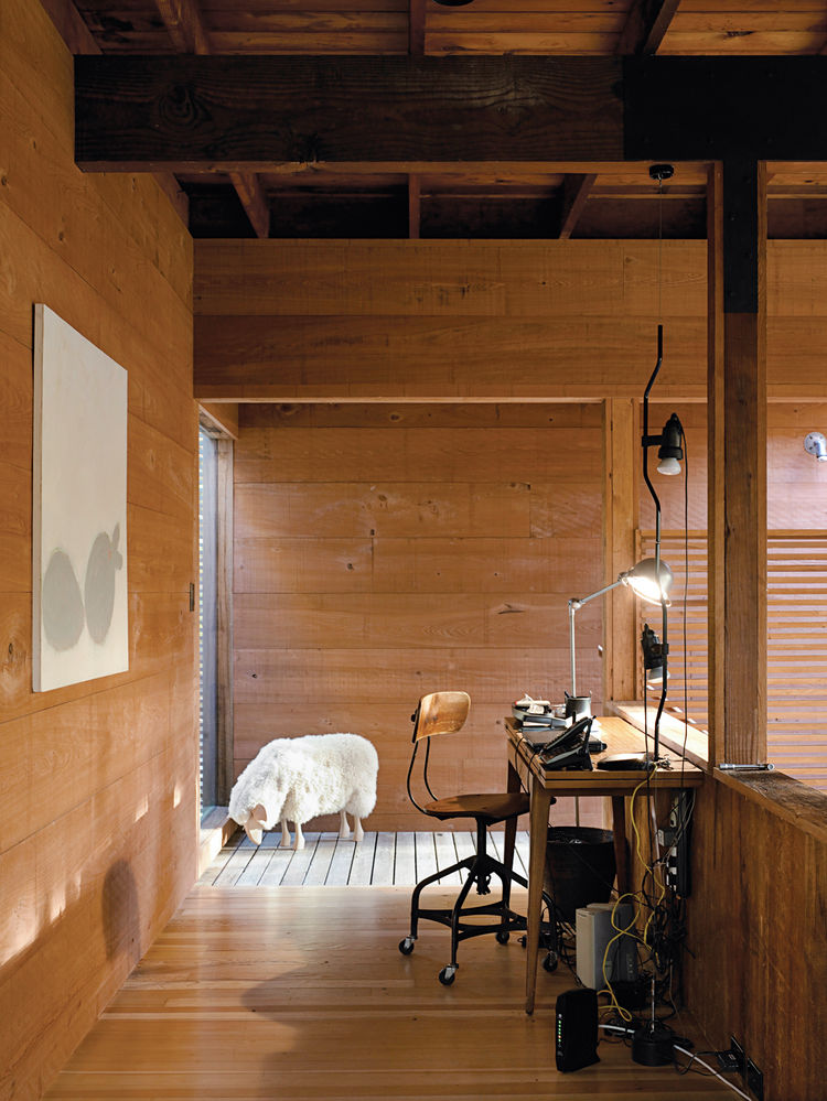"Inside Joe Dolce's cypress-clad house in Amagansett, New York, the office space is situated above the loft and is illuminated by Jielde steel lamps from France, which he collects. <a href=""http://www.dwell.com/articles/time-and-again.html"">Read the whole"