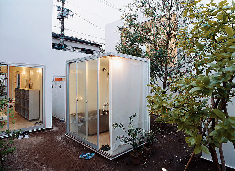 "The evening bath is a ritual in Japan, and public baths are still around, but this is a new twist. Moriyama curtains the bath during use, but won't cover any other windows, ""because it feels good to couple the inner space with the outside world."""