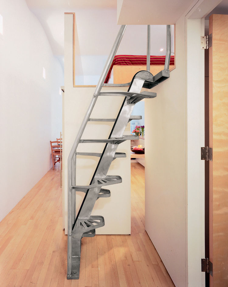 """The stair [by Lapeyre Stair] is very cost-effective, as compared to building woodwork,"" Woo explains. ""It occupies very little space, and you can come down without holding the rail."" Of the small gap that reveals the kitchen, he says, ""That's very import"