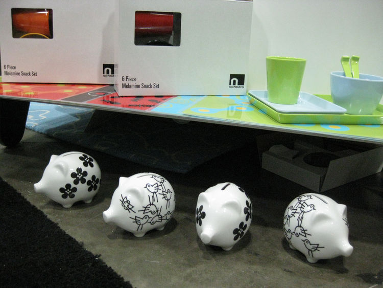 "A display of a six-piece melamine snack set and a collection of bold black-and-white piggy banks by <a href=""http://www.notneutral.com/"">notNeutral</a>. NotNeutral specializes in bright colors and patterns, creating ""design-orientated lifestyle products b"