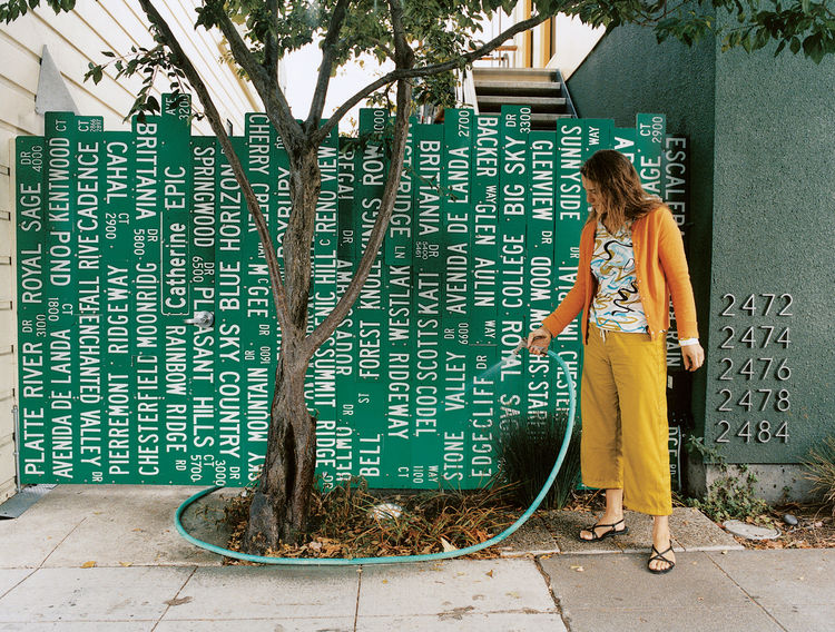 repurposed street signs as fence