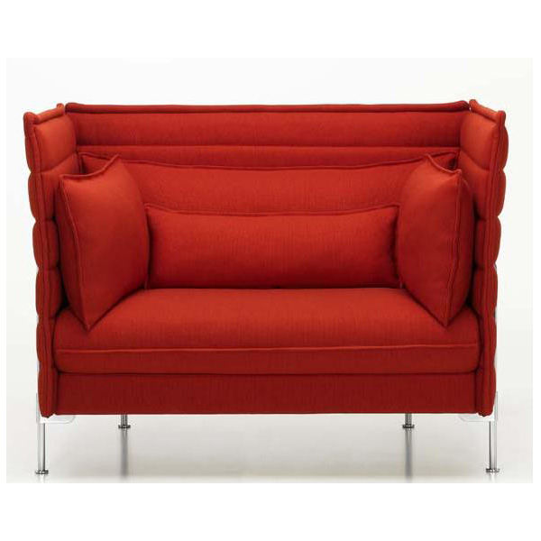 Red sofa with cushions.