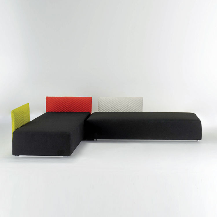 Modern sectional sofa with multi-colored cushions.