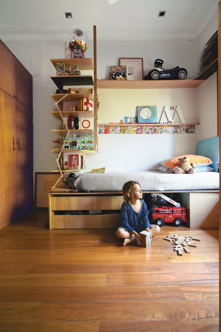 Boys bedroom with plywood bed and interlocking shelves and storage