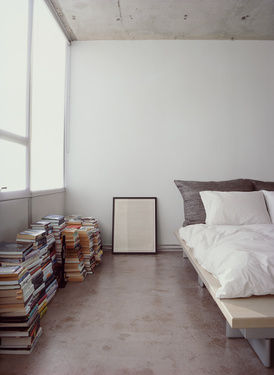 Hill house interior bedroom stacked books