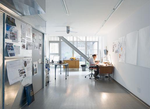 Weiner residence portrait at desk
