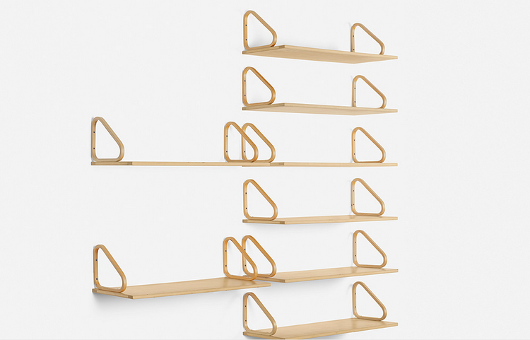 Modular laminated birch wall shelving by Alvar Aalto for Artek, on sale in Wright's Scandinavian auction.