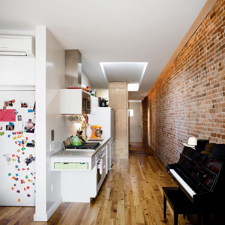 Narrow kitchen in New York City small apartment.